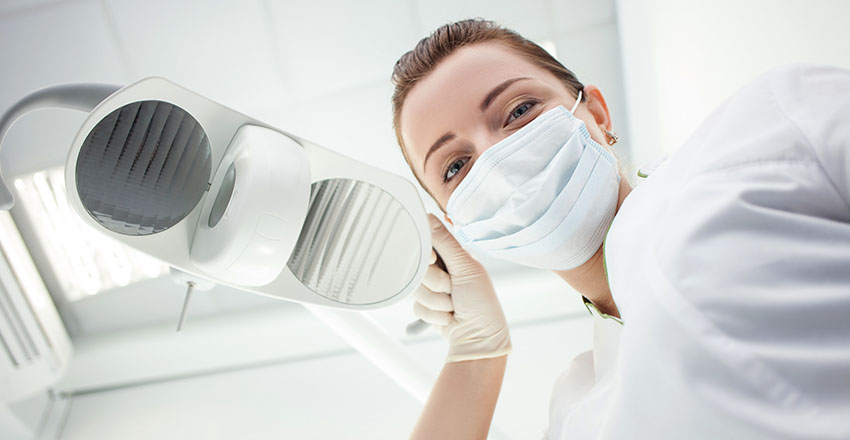 performing root canal